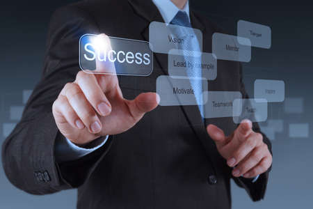 business focus: businessman hand pointing to success diagram as concept Stock Photo