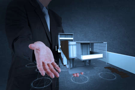 businessman hand shows house model as concept Stock Photo - 18237572