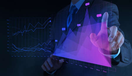 businessman hand drawing virtual chart business on touch screen computer Stock Photo - 18237498