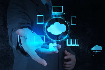 infrastructure: Businessman working with a Cloud Computing diagram on the new computer interface