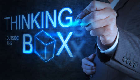 businessman hand draw thinking outside the box as concept photo