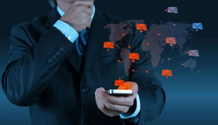 businessman hand use smart phone computer with modern email icon as concept photo