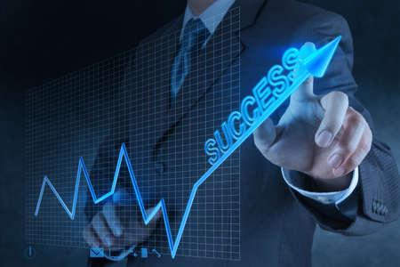 financial world: businessman hand touch virtual success chart business Stock Photo