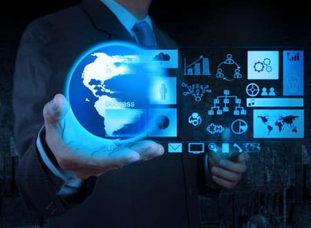 holding globe: imprenditore mano che regge il globo con diagramma attivit� su interfaccia touch screen