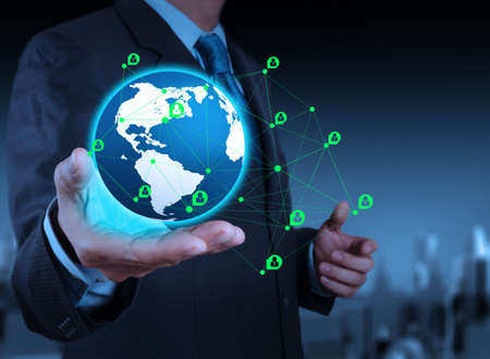 computer support: businessman working with new modern computer show social network structure on the earth Stock Photo
