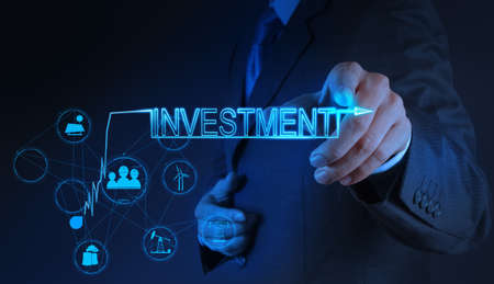 investment concept: businessman hand pointing to investment as concept Stock Photo