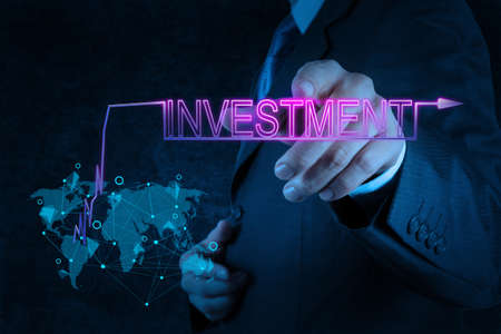businessman hand pointing to investment as concept photo