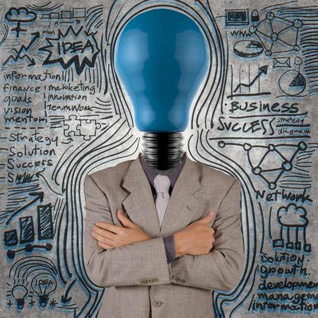 businessman with blue light bulb head as concept Stock Photo - 18237677