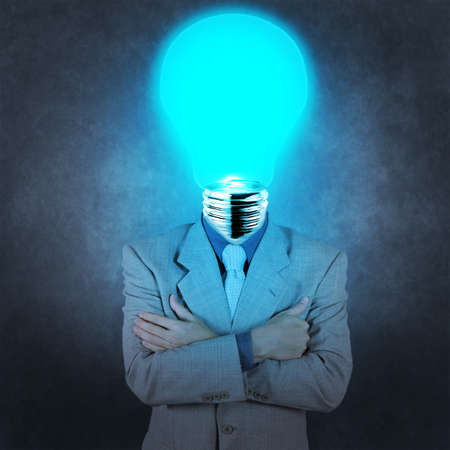 businessman with lamp-head as concept Stock Photo - 18237658