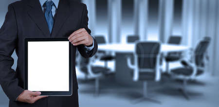 businessman success working with blank tablet computer his board room background photo