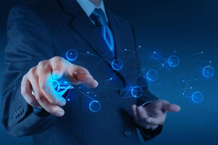 information science: businessman hand pushing solution diagram on a touch screen interface Stock Photo