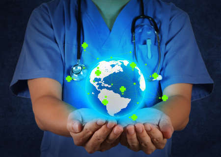 Medical Doctor holding a world globe in his hands as medical network concept Stock Photo - 18237609