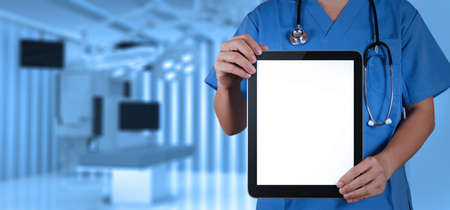 electronic pad: Doctor working with tablet computer with operating room