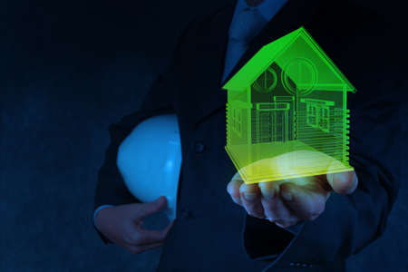 businessman hand shows house model as concept Stock Photo - 18237346
