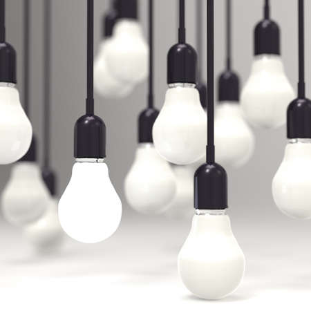 creative idea and leadership concept light bulb on grey background photo