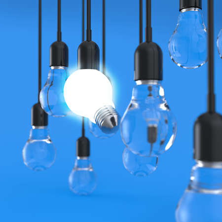 creative idea and leadership concept light bulb on blue background photo