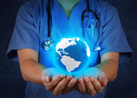 Medical Doctor holding a world globe in his hands as medical network concept Stock Photo - 18237594