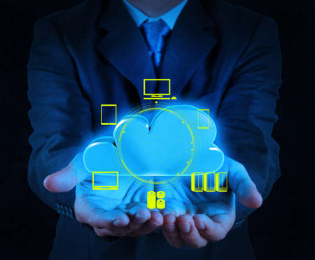 cloud services: Businessman working with a Cloud Computing diagram on the new computer interface