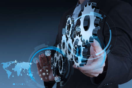 businessman hand working with coggear to success as concept Stock Photo