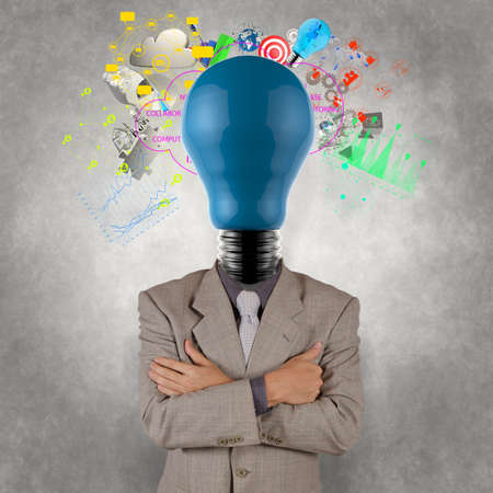 businessman with lamp-head as business success as concept design photo