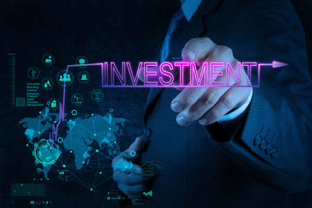 real estate investment: businessman hand pointing to investment diagram as concept Stock Photo