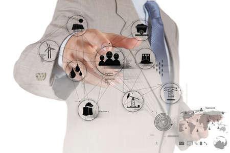 servicing: engineer hand works industry diagram on virtual computer as concept Stock Photo