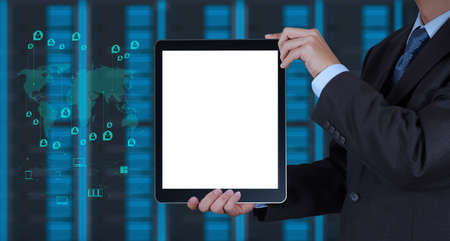 businessman hand using tablet computer and server room background as concept photo