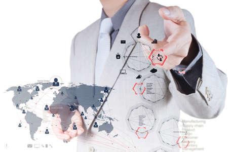desarrollo económico: empresario de la mano de trabajo con el nuevo equipo moderno y la estrategia de negocio y la red social como concepto Foto de archivo