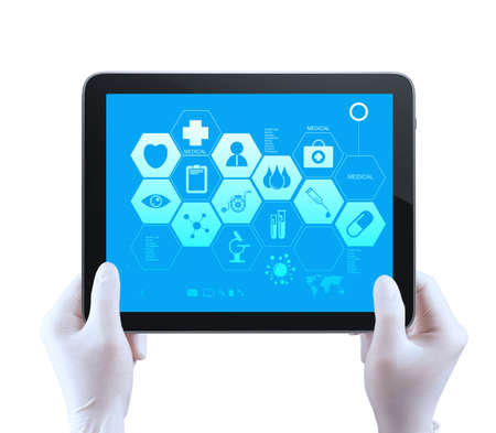 Medicine doctor hand  shows tablet compuer with medical computer interface as concept photo