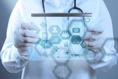 medical computer: Medicine doctor working with modern computer interface as medical concept Stock Photo