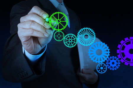 vision concept: businessman hand draw leader cog gear to success concept