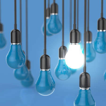 yellow lamp: creative idea and leadership concept light bulb on color background