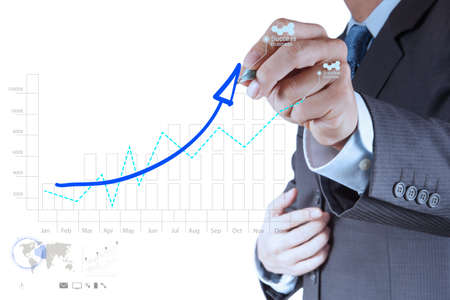 desarrollo econ�mico: mano negocios que trabajan con ordenador nuevo y moderno y el ?xito empresarial como concepto Foto de archivo