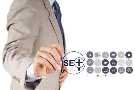 businessman hand showing search engine optimization SEO as concept Stock Photo - 19646267