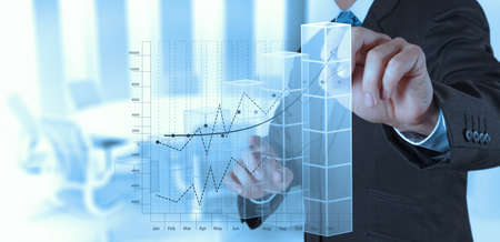financial target: businessman hand working with new modern computer and business strategy as concept Stock Photo