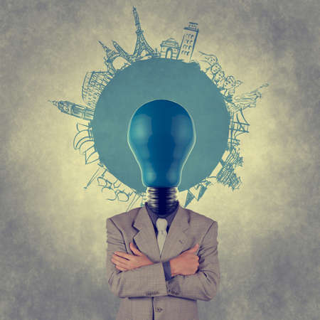businessman and light bulb head and traveling around the world as vintage style concept Stock Photo - 19646925