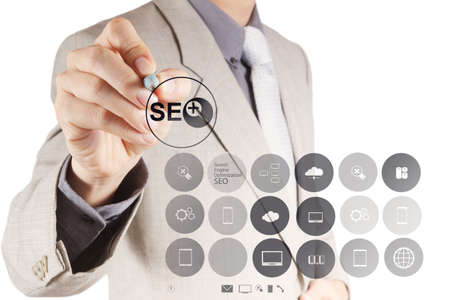 businessman hand showing search engine optimization SEO as concept Stock Photo - 19646266