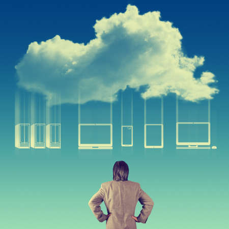 Businessman hand looking at a Cloud Computing diagram  as vintage concept photo