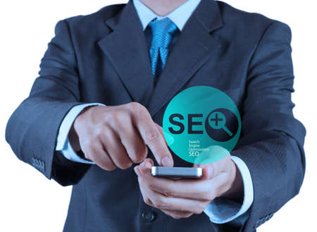 businessman hand showing search engine optimization SEO as concept Stock Photo - 19646654