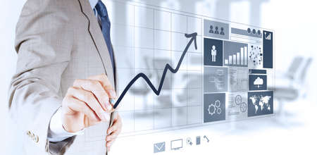 financial performance: businessman hand working with new modern computer and business strategy as concept Stock Photo