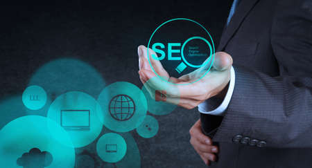 businessman hand showing search engine optimization SEO as concept Stock Photo - 19646784