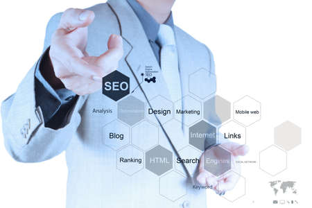 businessman hand showing search engine optimization SEO as concept Stock Photo - 19646274