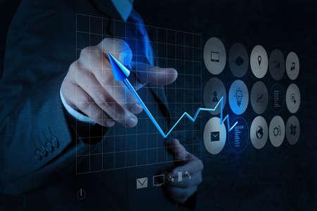 tendencja: strony rysunku biznesmen wirtualny biznes wykres na komputerze ekran dotykowy jako koncepcji Zdjęcie Seryjne