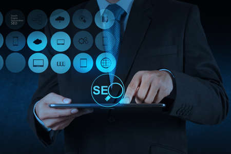 optimize: businessman hand showing search engine optimization SEO as concept