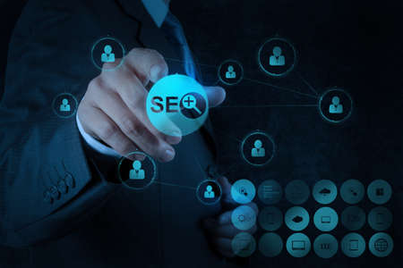 businessman hand showing search engine optimization SEO as concept Stock Photo - 19646280