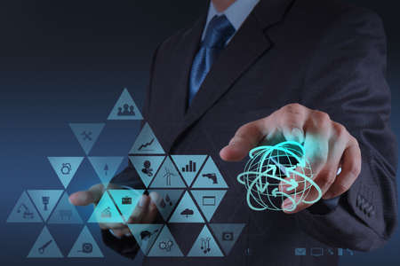 pressing: Businessman hand working with virtual interface show globalization and technology as concept