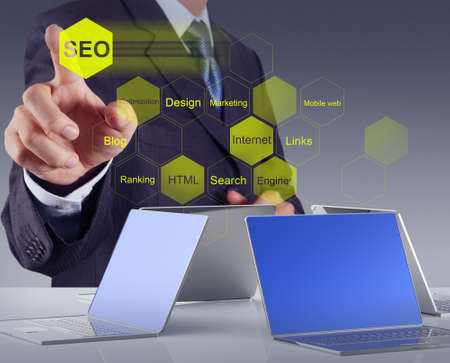 keywords link: businessman hand showing search engine optimization SEO as concept