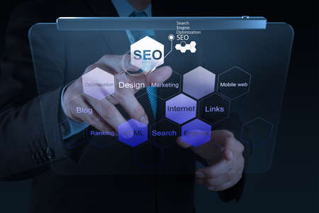 businessman hand showing search engine optimization SEO as concept Stock Photo - 19646275