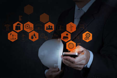 businessman engineer hand use smart phone computer as concept