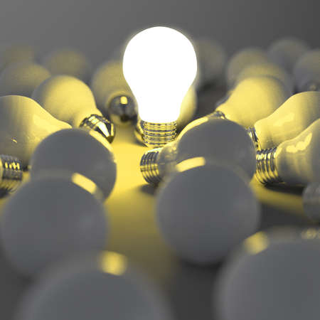 innovating: 3d growing light bulb standing out from the unlit incandescent bulbs as leadership concept
